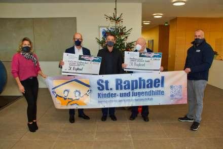Scheckübergabe an St. Raphael bei der Gerhard Schubert GmbH